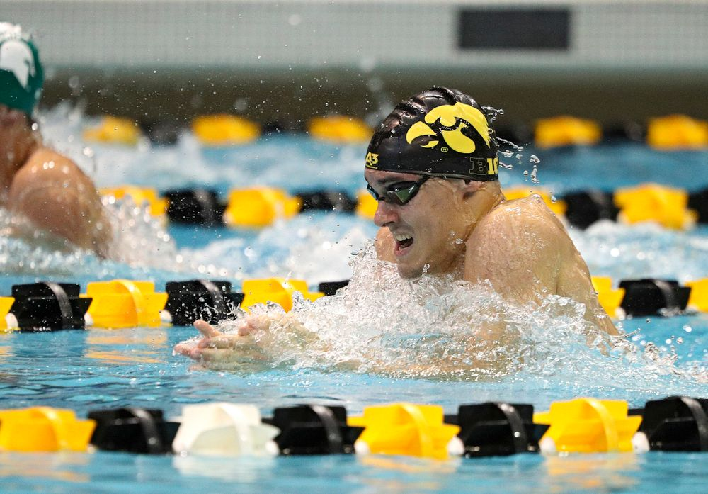Iowa's Daniel Swanepoel swims the men's 100-yard breaststroke event during their meet against Michigan State and Northern Iowa at the Campus Recreation and Wellness Center in Iowa City on Friday, Oct 4, 2019. (Stephen Mally/hawkeyesports.com)