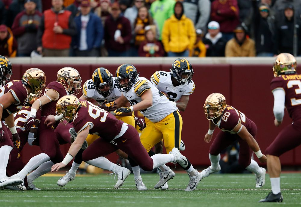 Iowa Hawkeyes fullback Brady Ross (36) blocks for wide receiver Ihmir Smith-Marsette (6) as he returns a kick against the Minnesota Golden Gophers Saturday, October 6, 2018 at TCF Bank Stadium. (Brian Ray/hawkeyesports.com)