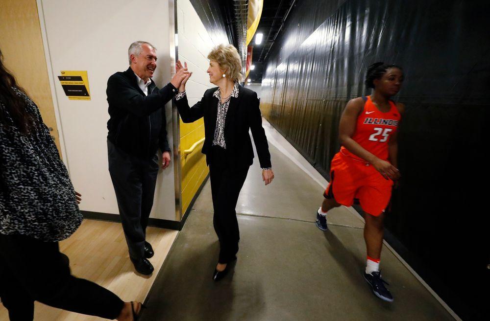 Head coach Lisa Bluder, Athletics Director Gary Barta