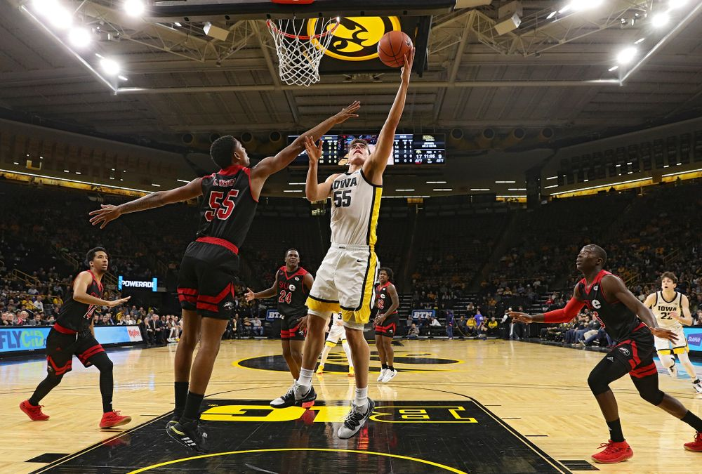 Iowa Hawkeyes center Luka Garza (55) scores a basket in the paint during the first half of their game at Carver-Hawkeye Arena in Iowa City on Friday, Nov 8, 2019. (Stephen Mally/hawkeyesports.com)