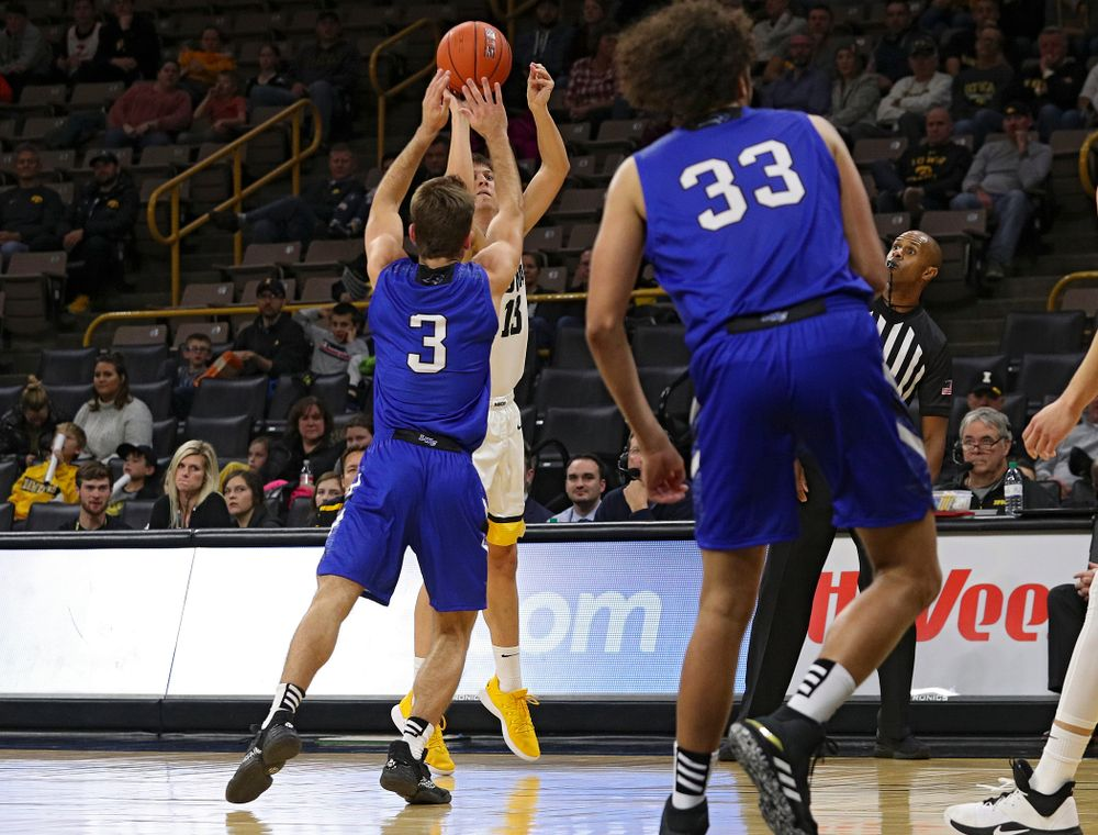 Iowa Hawkeyes guard Austin Ash (13) makes a 3-pointer during the second half of their exhibition game against Lindsey Wilson College at Carver-Hawkeye Arena in Iowa City on Monday, Nov 4, 2019. (Stephen Mally/hawkeyesports.com)