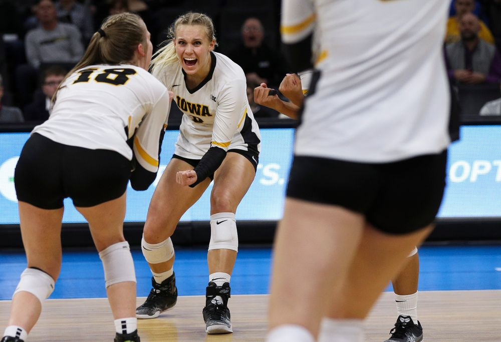 Iowa Hawkeyes right side hitter Reghan Coyle (8) celebrates after winning a point during a match against Nebraska at Carver-Hawkeye Arena on November 7, 2018. (Tork Mason/hawkeyesports.com)