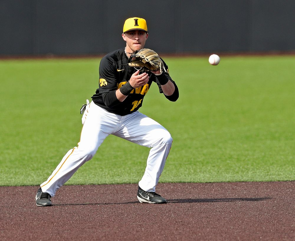 Iowa Hawkeyes shortstop Tanner Wetrich (16) fields a ground ball during the sixth inning of their game against Rutgers at Duane Banks Field in Iowa City on Saturday, Apr. 6, 2019. (Stephen Mally/hawkeyesports.com)