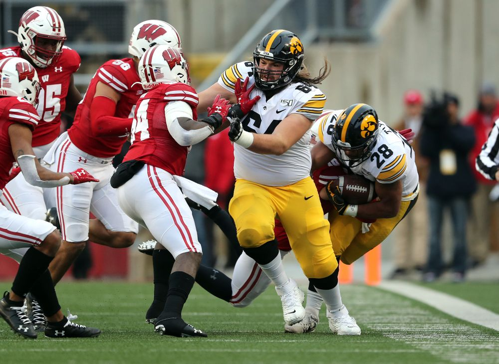 Iowa Hawkeyes offensive lineman Kyler Schott (64) and running back Toren Young (28) against the Wisconsin Badgers Saturday, November 9, 2019 at Camp Randall Stadium in Madison, Wisc. (Brian Ray/hawkeyesports.com)