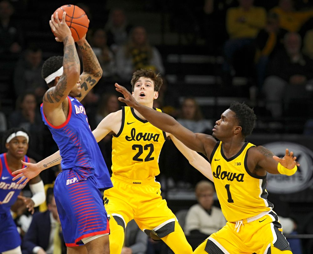 Iowa Hawkeyes forward Patrick McCaffery (22) and guard Joe Toussaint (1) apply pressure during the first half of their game at Carver-Hawkeye Arena in Iowa City on Monday, Nov 11, 2019. (Stephen Mally/hawkeyesports.com)
