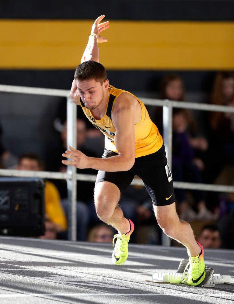 Collin Hofacker competes in the 400 meters