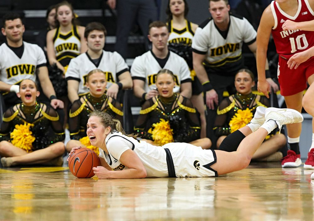 Iowa Hawkeyes guard Kathleen Doyle (22) grabs a loose ball on the floor during the fourth quarter of their game at Carver-Hawkeye Arena in Iowa City on Sunday, January 12, 2020. (Stephen Mally/hawkeyesports.com)