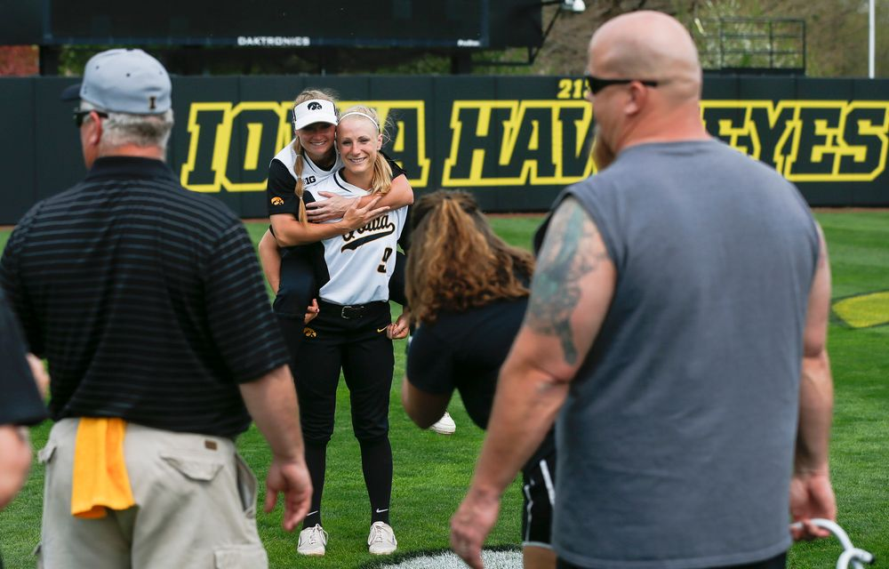 Iowa Hawkeyes outfielder Cheyenne Pratt (27), Iowa Hawkeyes infielder Sarah Kurtz (9)