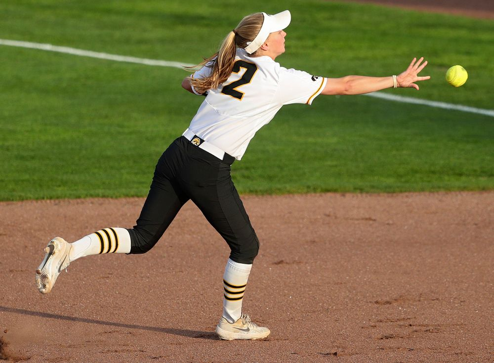Iowa second baseman Aralee Bogar (2) tosses the ball to first base as she turns an inning ending double play during the sixth inning of their game against Ohio State at Pearl Field in Iowa City on Friday, May. 3, 2019. (Stephen Mally/hawkeyesports.com)