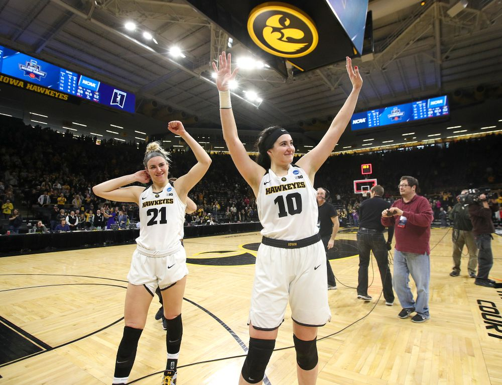 Iowa Hawkeyes forward Hannah Stewart (21) and center Megan Gustafson (10) wave to the crowd after winning their second round game in the 2019 NCAA Women's Basketball Tournament at Carver Hawkeye Arena in Iowa City on Sunday, Mar. 24, 2019. (Stephen Mally for hawkeyesports.com)