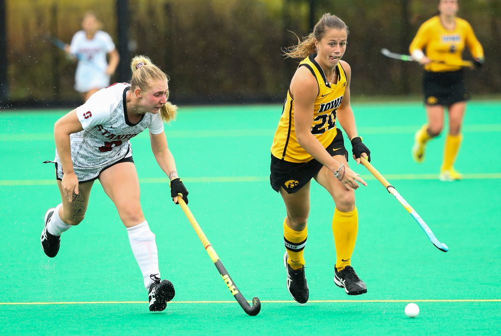 Iowa Hawkeyes midfielder Sophie Sunderland (20) dribbles during a game against Stanford at Grant Field on October 7, 2018. (Tork Mason/hawkeyesports.com)