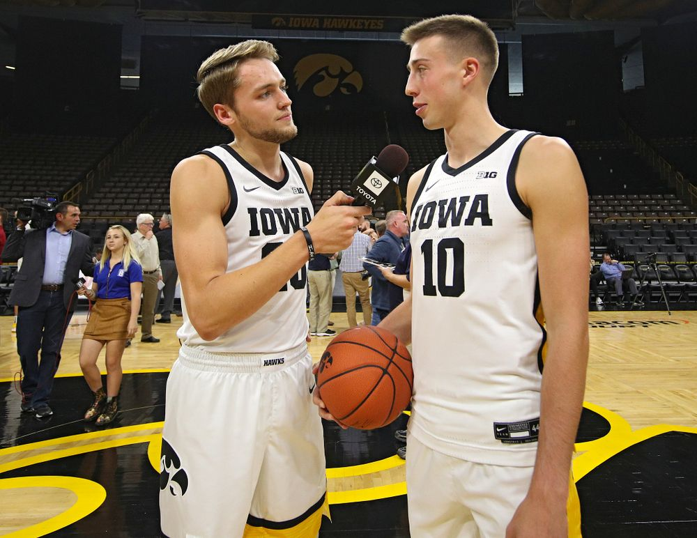 Iowa Hawkeyes forward Riley Till (20) asks guard Joe Wieskamp (10) a question during Iowa Men's Basketball Media Day at Carver-Hawkeye Arena in Iowa City on Wednesday, Oct 9, 2019. (Stephen Mally/hawkeyesports.com)