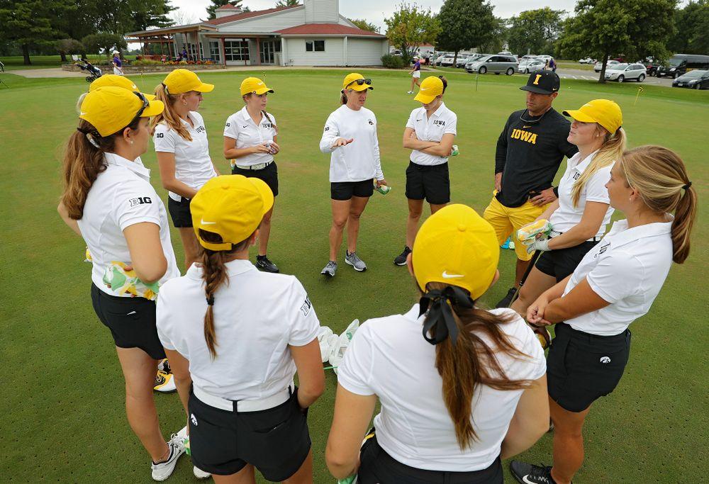 Iowa head coach Megan Menzel talks with her team before their dual against Northern Iowa at Pheasant Ridge Golf Course in Cedar Falls on Monday, Sep 2, 2019. (Stephen Mally/hawkeyesports.com)