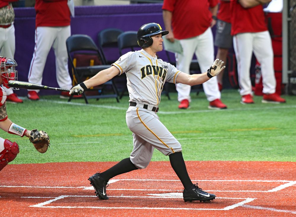 Iowa Hawkeyes outfielder Justin Jenkins (6) hits an RBI double during the seventh inning of their CambriaCollegeClassic game at U.S. Bank Stadium in Minneapolis, Minn. on Friday, February 28, 2020. (Stephen Mally/hawkeyesports.com)