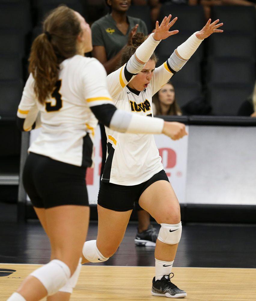 Iowa Hawkeyes defensive specialist Emily Bushman (12)