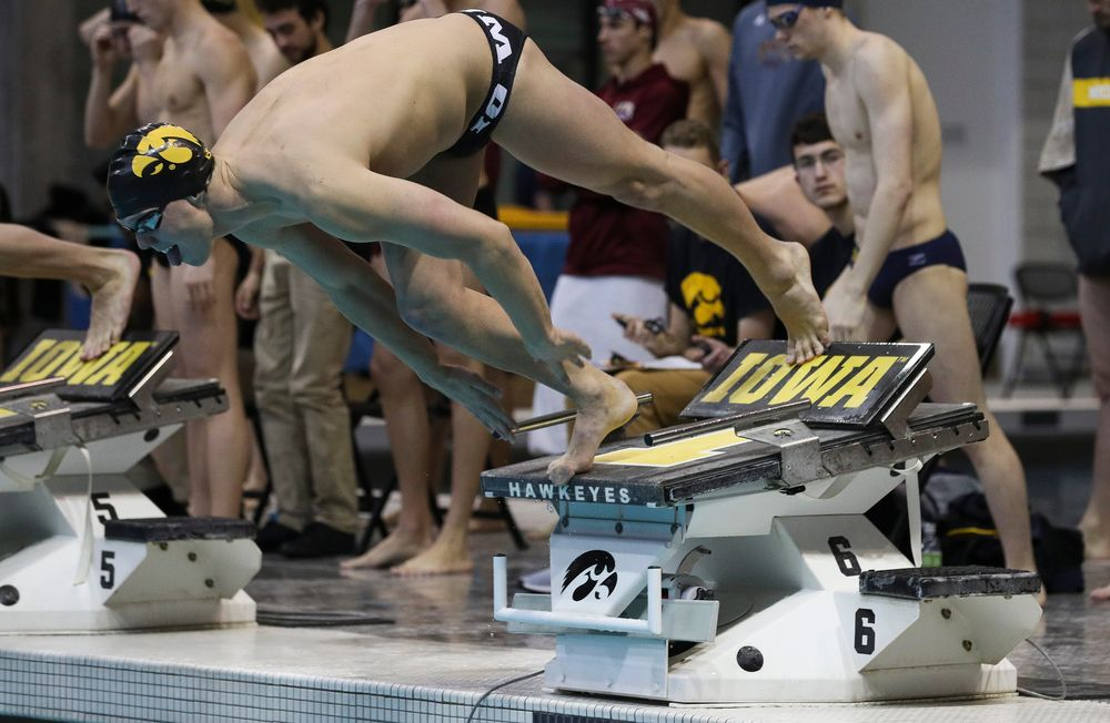Iowa's Forrest White competes in the 200-yard freestyle relay during a meet against Michigan and Denver at the Campus Recreation and Wellness Center on November 3, 2018. (Tork Mason/hawkeyesports.com)