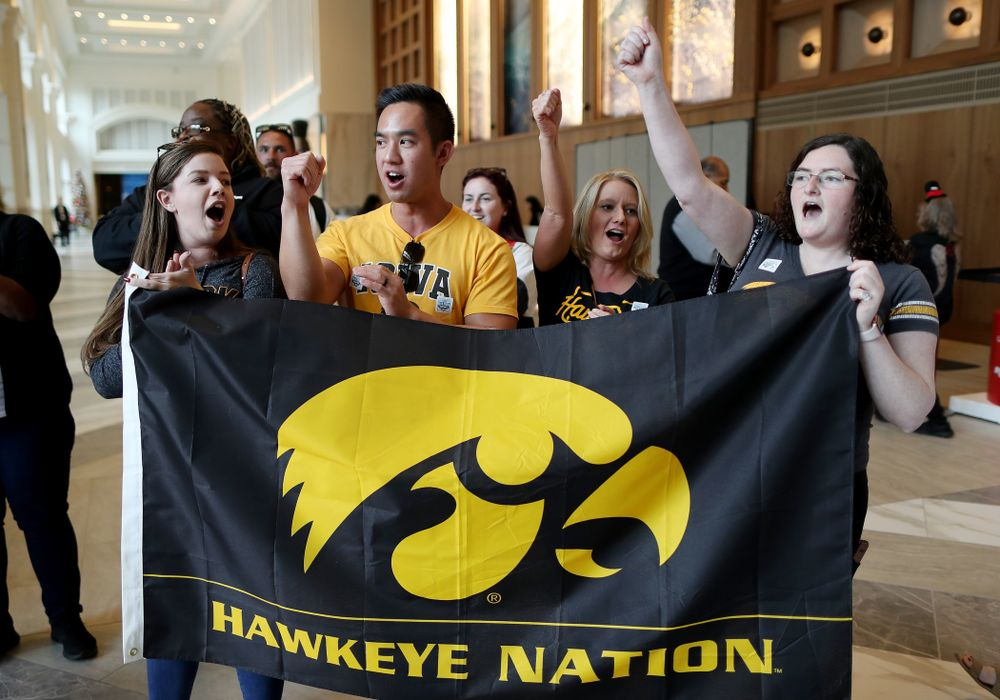 Fans sing the Fight Song and cheer on the Iowa Hawkeyes after arriving in San Diego, CA Saturday, December 21, 2019 for the Holiday Bowl. (Brian Ray/hawkeyesports.com)