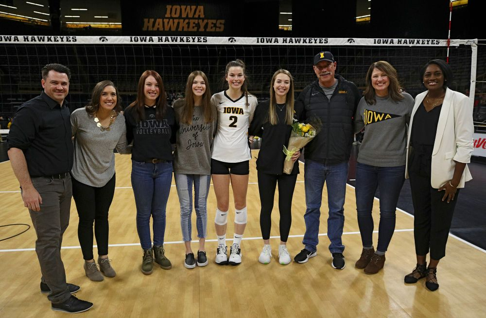 Iowa's Meghan Buzzerio (5) is honored with her family and the coaching staff on Senior Day before their match at Carver-Hawkeye Arena in Iowa City on Saturday, Nov 30, 2019. (Stephen Mally/hawkeyesports.com)
