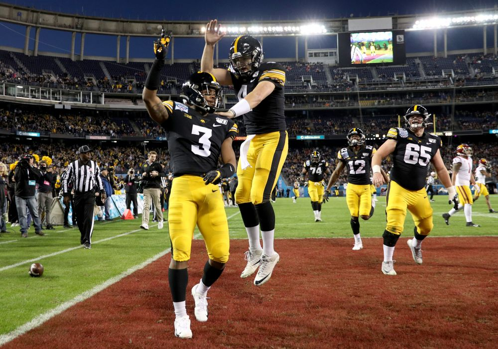Iowa Hawkeyes wide receiver Tyrone Tracy Jr. (3) and quarterback Nate Stanley (4) celebrate after scoring against USC in the Holiday Bowl Friday, December 27, 2019 at San Diego Community Credit Union Stadium.  (Brian Ray/hawkeyesports.com)