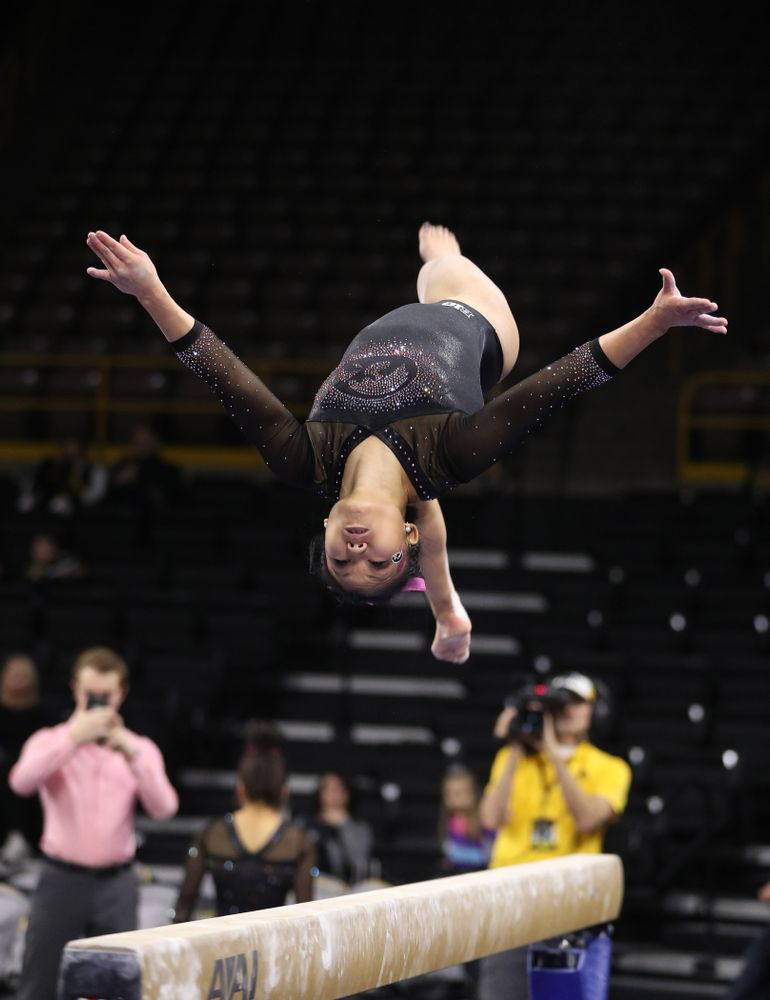 Iowa's Lauren Guerin competes on the bars during their meet against the Minnesota Golden Gophers Saturday, January 19, 2019 at Carver-Hawkeye Arena. (Brian Ray/hawkeyesports.com)