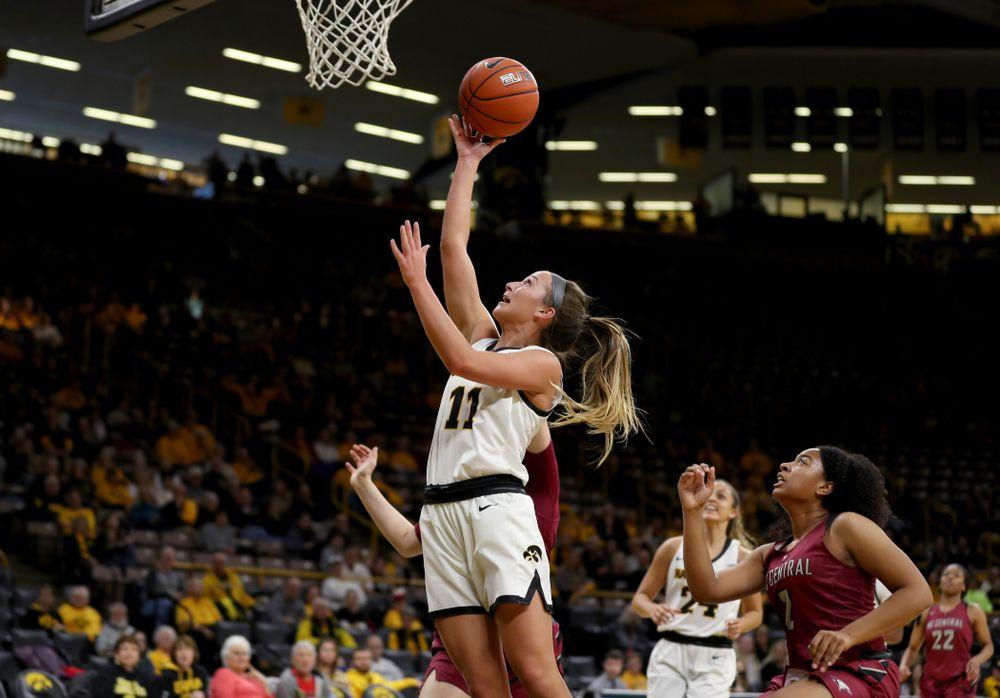 Iowa Hawkeyes guard Megan Meyer (11) goes to the hoop against North Carolina Central Saturday, December 14, 2019 at Carver-Hawkeye Arena. (Brian Ray/hawkeyesports.com)