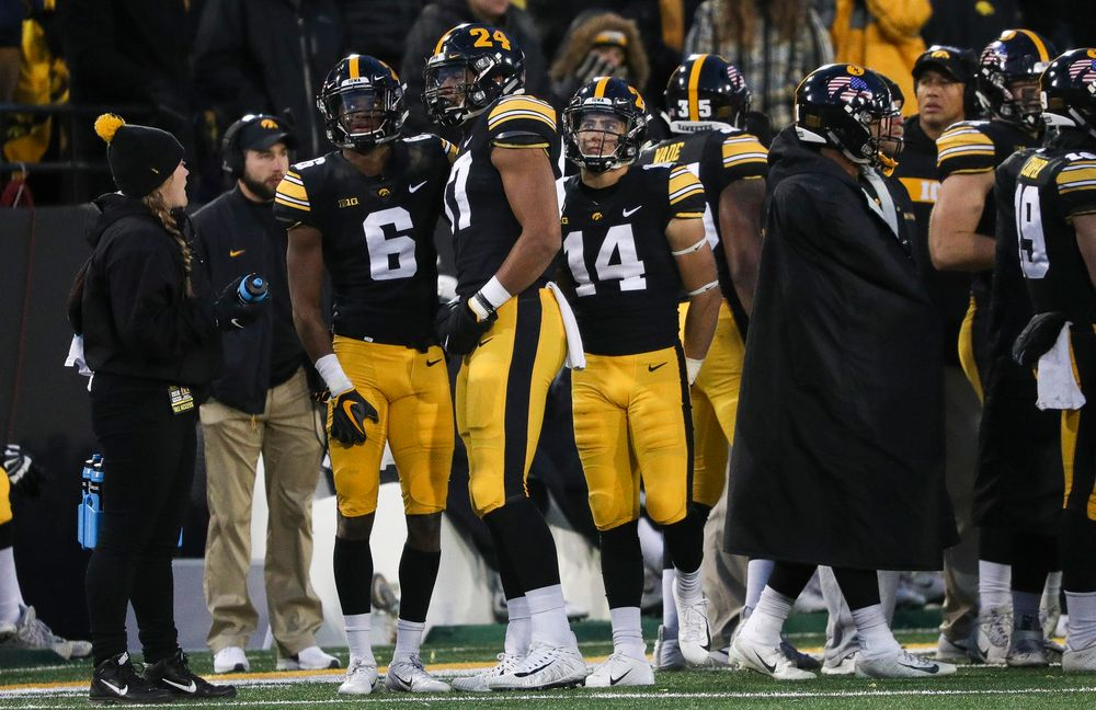 Iowa Hawkeyes wide receiver Ihmir Smith-Marsette (6) watches the video board as officials review his catch, which was originally ruled incomplete, during a game against Northwestern at Kinnick Stadium on November 10, 2018. (Tork Mason/hawkeyesports.com)