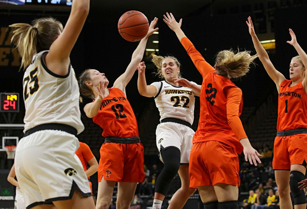Iowa guard Kathleen Doyle (22) passes the ball to forward/center Monika Czinano (25) who scores during the first quarter of their overtime win against Princeton at Carver-Hawkeye Arena in Iowa City on Wednesday, Nov 20, 2019. (Stephen Mally/hawkeyesports.com)