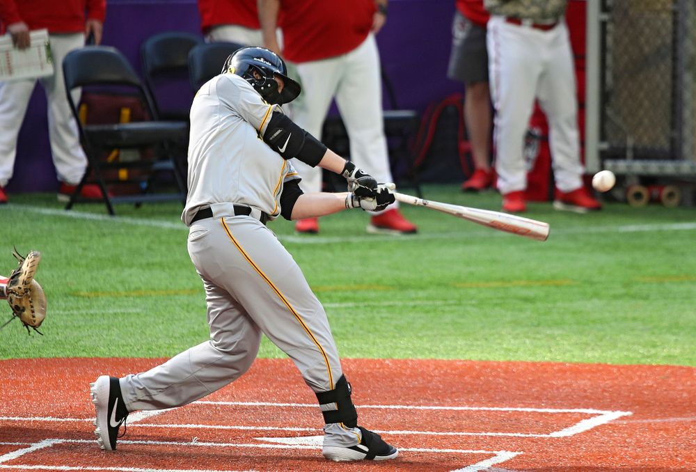 Iowa Hawkeyes outfielder Zeb Adreon (5) drives a pitch for a hit during the seventh inning of their CambriaCollegeClassic game at U.S. Bank Stadium in Minneapolis, Minn. on Friday, February 28, 2020. (Stephen Mally/hawkeyesports.com)