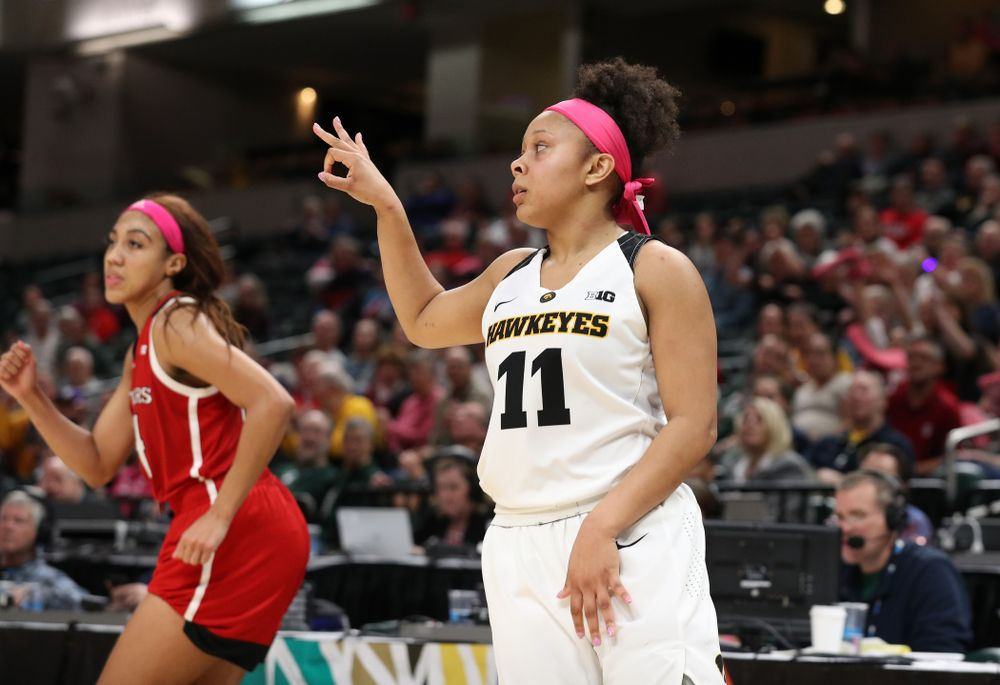 Iowa Hawkeyes guard Makenzie Meyer (3) celebrates a three point basket against the Rutgers Scarlet Knights in the semi-finals of the Big Ten Tournament Saturday, March 9, 2019 at Bankers Life Fieldhouse in Indianapolis, Ind. (Brian Ray/hawkeyesports.com)