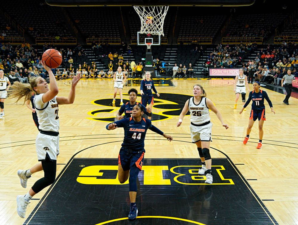 Iowa Hawkeyes guard Kathleen Doyle (22) takes a pass and scores during the fourth quarter of their game at Carver-Hawkeye Arena in Iowa City on Tuesday, December 31, 2019. (Stephen Mally/hawkeyesports.com)
