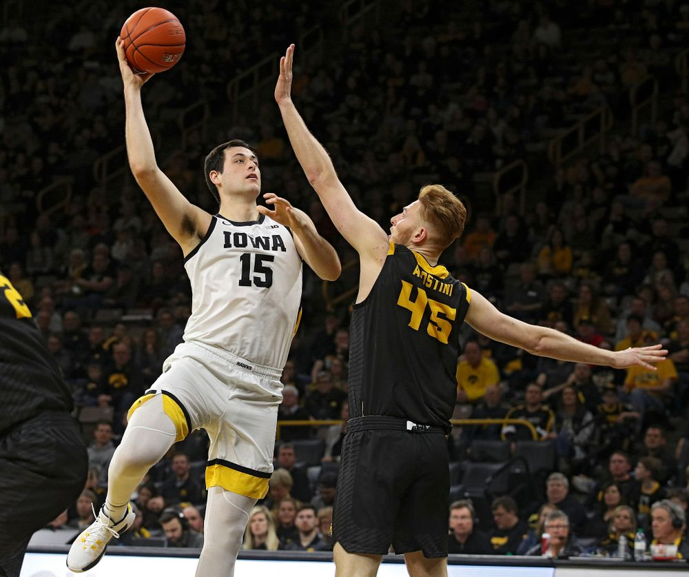 Iowa Hawkeyes forward Ryan Kriener (15) hooks in a basket during the second half of their their game at Carver-Hawkeye Arena in Iowa City on Sunday, December 29, 2019. (Stephen Mally/hawkeyesports.com)