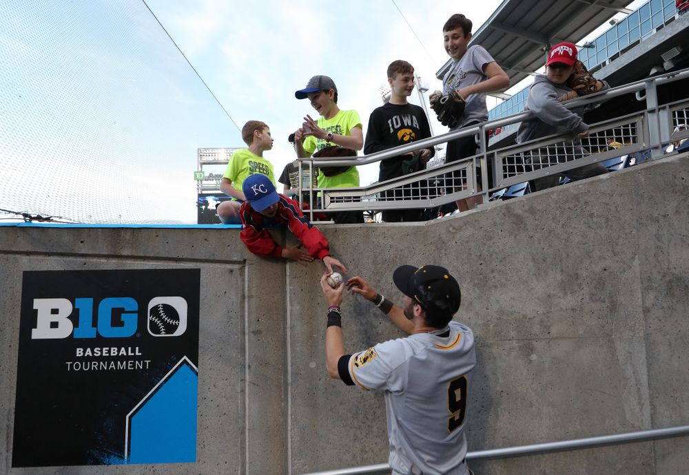 Iowa Hawkeyes outfielder Ben Norman (9) signs autographs following their game against the Indiana Hoosiers in the first round of the Big Ten Baseball Tournament Wednesday, May 22, 2019 at TD Ameritrade Park in Omaha, Neb. (Brian Ray/hawkeyesports.com)