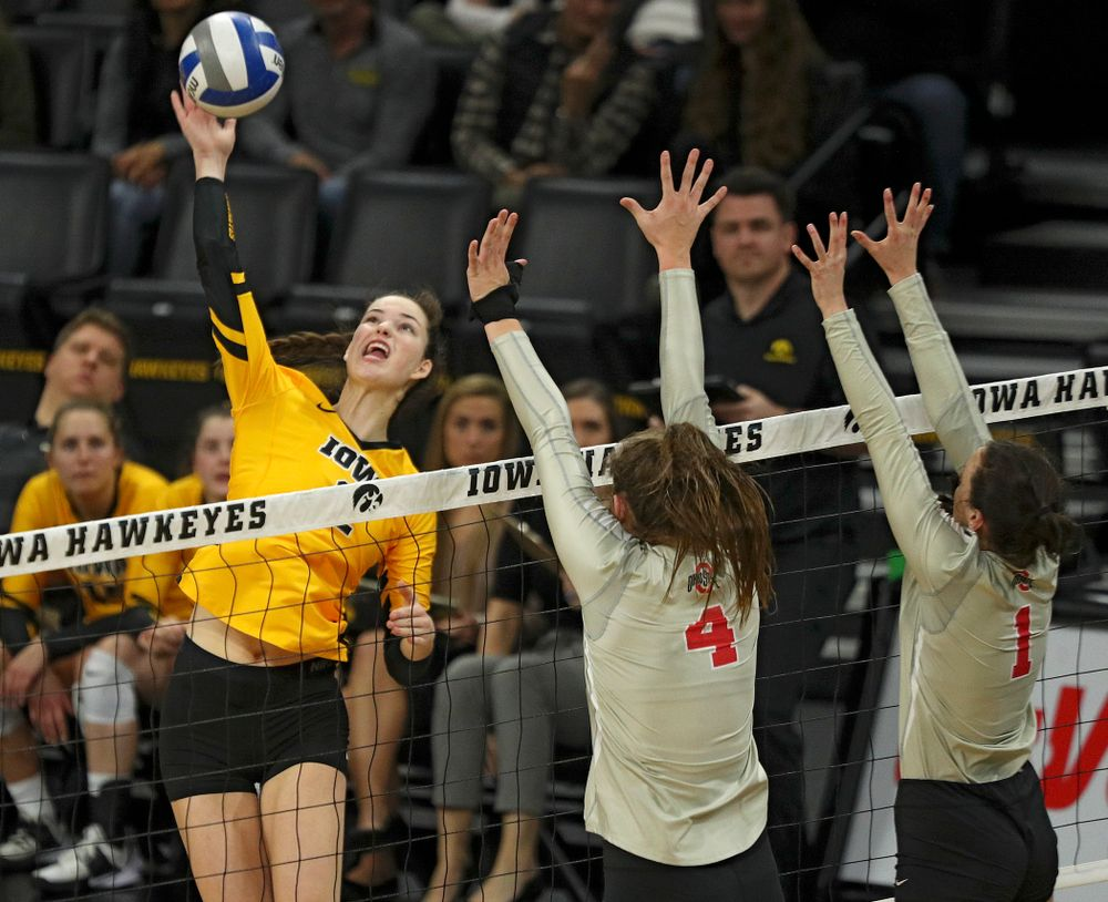 Iowa's Courtney Buzzerio (2) gets up for a kill during the second set of their match at Carver-Hawkeye Arena in Iowa City on Friday, Nov 29, 2019. (Stephen Mally/hawkeyesports.com)