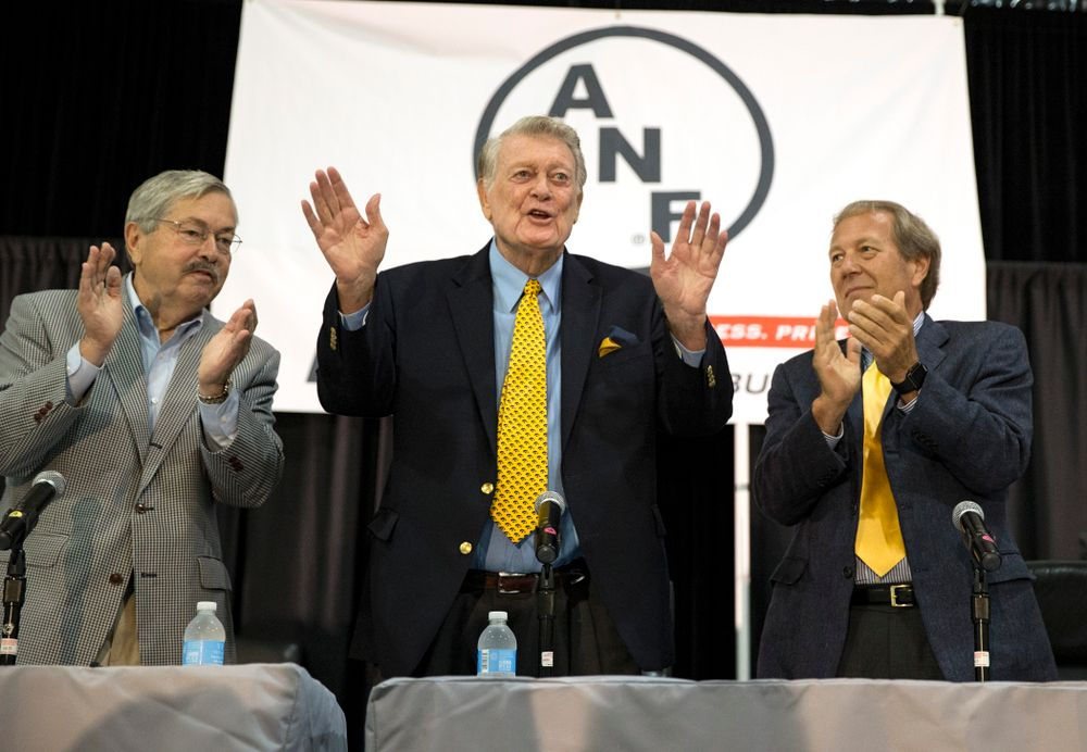 Former Hawkeye Football head coach Hayden Fry stands with new University of Iowa President Bruce Harreld, and Governor Terry Branstad during FryFest Friday, Sept. 4, 2015 at the Coralville Marriott Hotel and Convention Center. Branstad honored Fry with a proclamation commemorating his creation of the ANF logo and his support of Iowa farmers.  (Brian Ray/hawkeyesports.com)