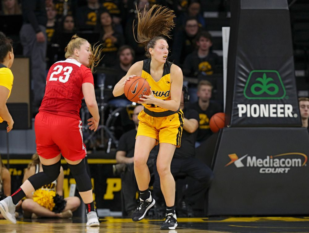 Iowa Hawkeyes forward Amanda Ollinger (43) looks to pass after blocking a shot by Ohio State Buckeyes forward Rebeka Mikulasikova (23) during the third quarter of their game at Carver-Hawkeye Arena in Iowa City on Thursday, January 23, 2020. (Stephen Mally/hawkeyesports.com)