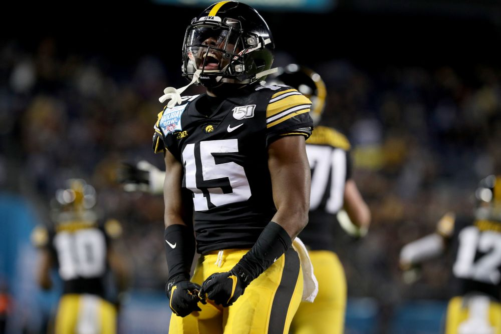 Iowa Hawkeyes running back Tyler Goodson (15) celebrates a touchdown against USC in the Holiday Bowl Friday, December 27, 2019 at San Diego Community Credit Union Stadium.  (Brian Ray/hawkeyesports.com)