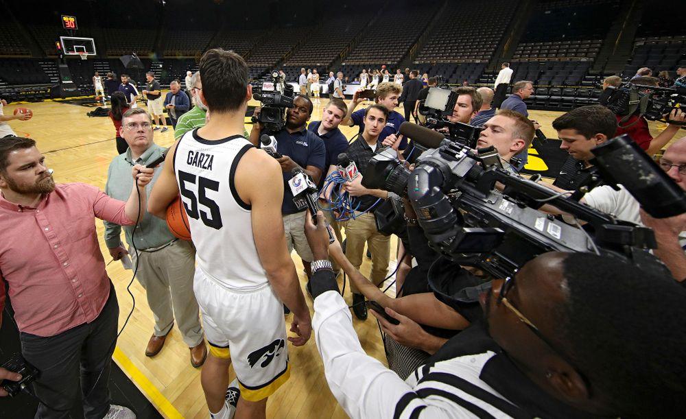 Iowa Hawkeyes forward Luka Garza (55) answers questions during Iowa Men's Basketball Media Day at Carver-Hawkeye Arena in Iowa City on Wednesday, Oct 9, 2019. (Stephen Mally/hawkeyesports.com)