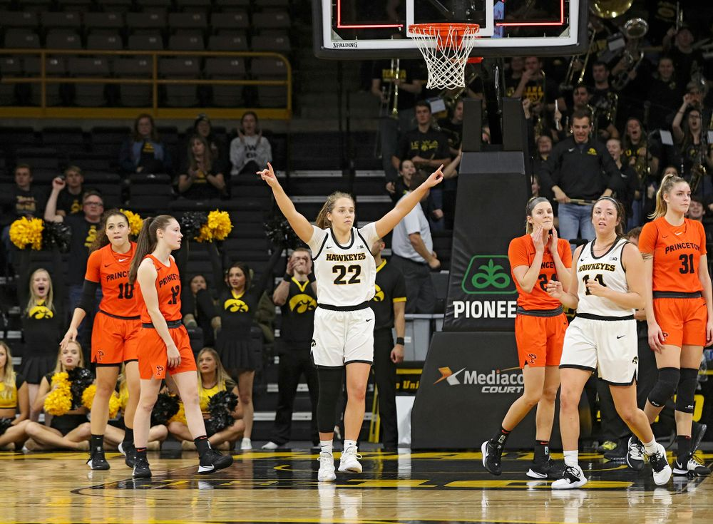 Iowa guard Kathleen Doyle (22) raises her hands during overtime in their win against Princeton at Carver-Hawkeye Arena in Iowa City on Wednesday, Nov 20, 2019. (Stephen Mally/hawkeyesports.com)