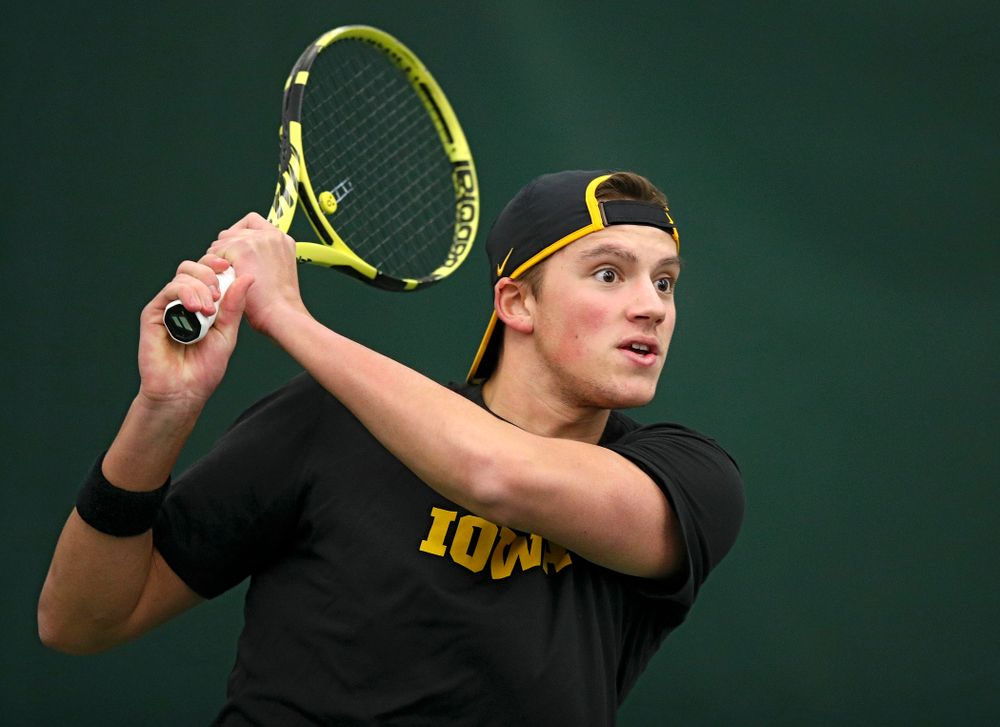 Iowa's Joe Tyler returns a shot during their match at the Hawkeye Tennis and Recreation Complex in Iowa City on Thursday, January 16, 2020. (Stephen Mally/hawkeyesports.com)