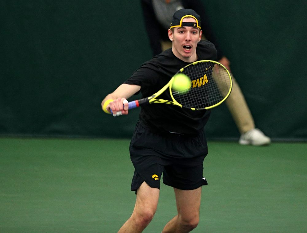 Iowa's Nikita Snezhko returns a shot during his doubles match at the Hawkeye Tennis and Recreation Complex in Iowa City on Friday, March 6, 2020. (Stephen Mally/hawkeyesports.com)