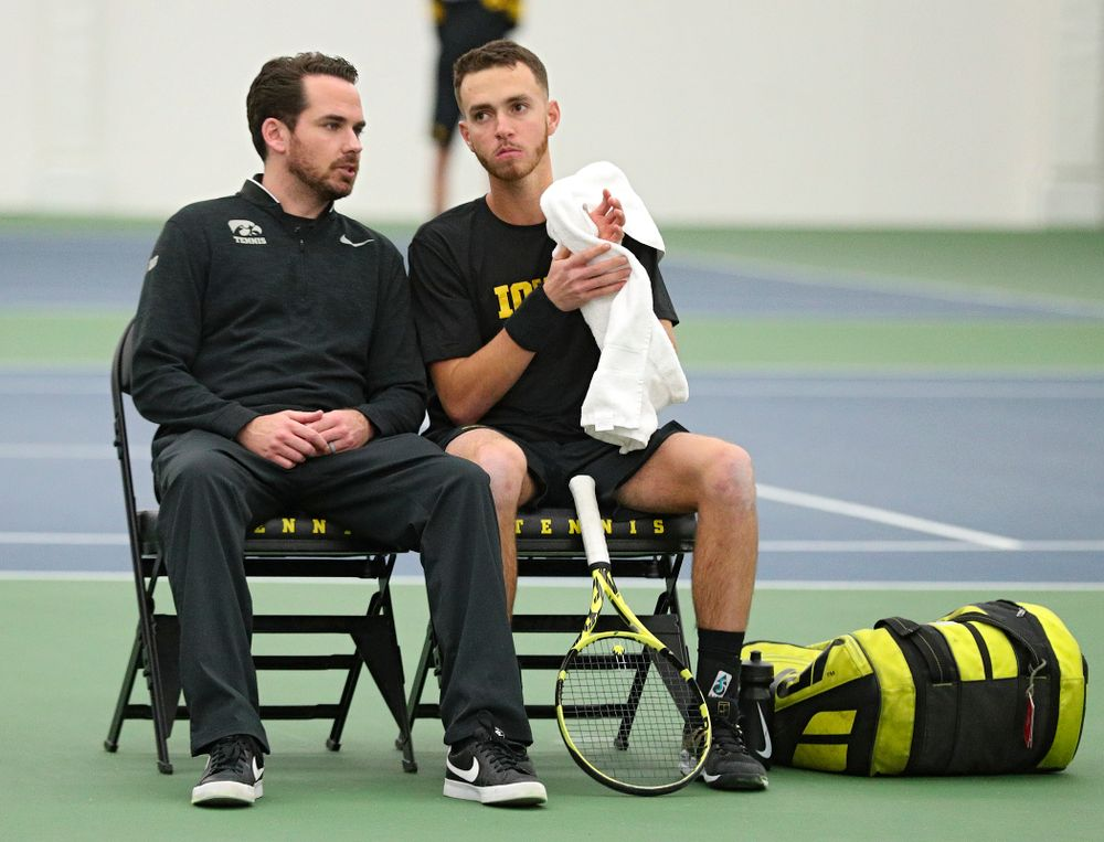 Mellecker Family Head Men's Tennis Coach Ross Wilson (from left) talks with Kareem Allaf during his singles match at the Hawkeye Tennis and Recreation Complex in Iowa City on Friday, February 14, 2020. (Stephen Mally/hawkeyesports.com)