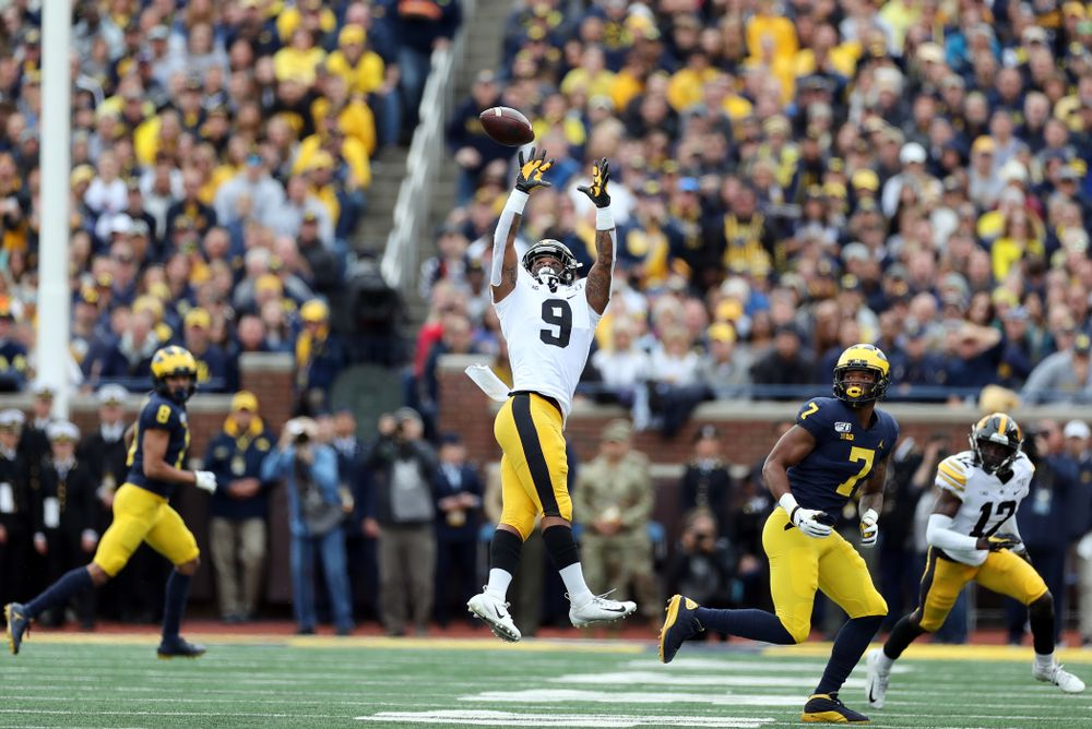 Iowa Hawkeyes defensive back Geno Stone (9) intercepts a pass against the Michigan Wolverines Saturday, October 5, 2019 at Michigan Stadium in Ann Arbor, MI. (Brian Ray/hawkeyesports.com)