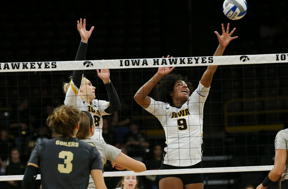 Iowa Hawkeyes right side hitter Reghan Coyle (8) and Iowa Hawkeyes middle blocker Amiya Jones (9) go up for a block during a game against Purdue at Carver-Hawkeye Arena on October 13, 2018. (Tork Mason/hawkeyesports.com)