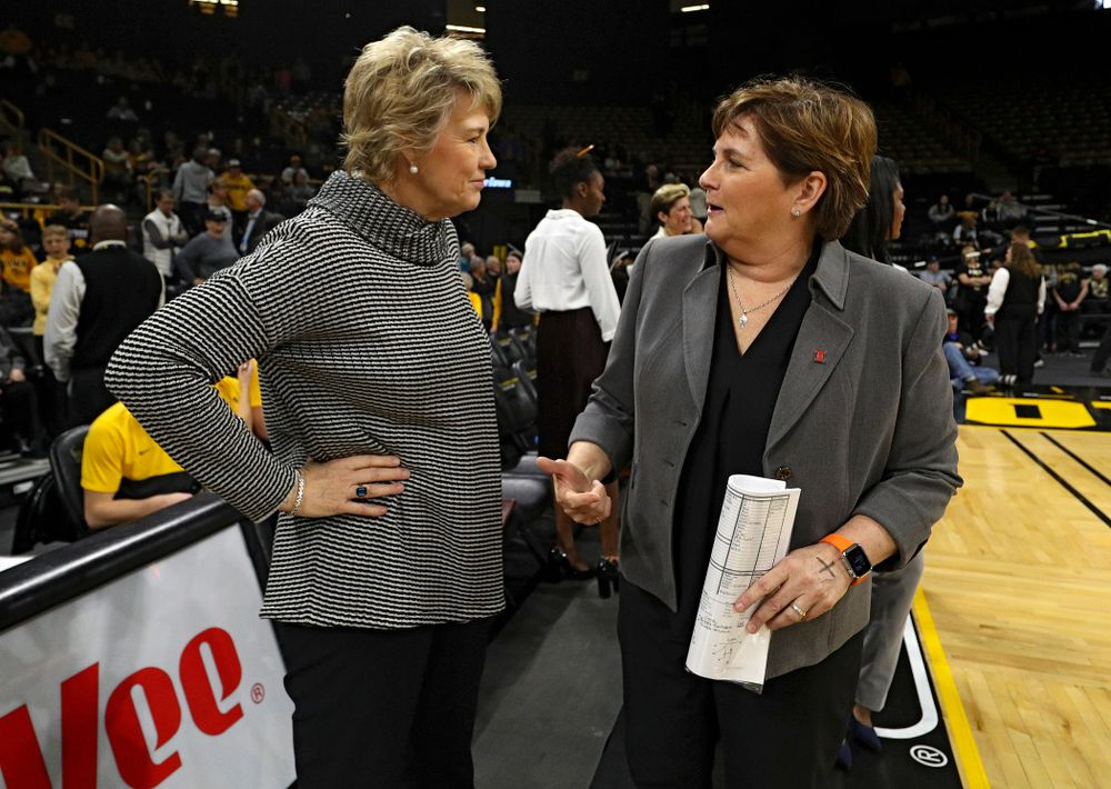 Iowa Hawkeyes head coach Lisa Bluder talks with Illinois Fighting Illini head coach Nancy Fahey before their game at Carver-Hawkeye Arena in Iowa City on Tuesday, December 31, 2019. (Stephen Mally/hawkeyesports.com)