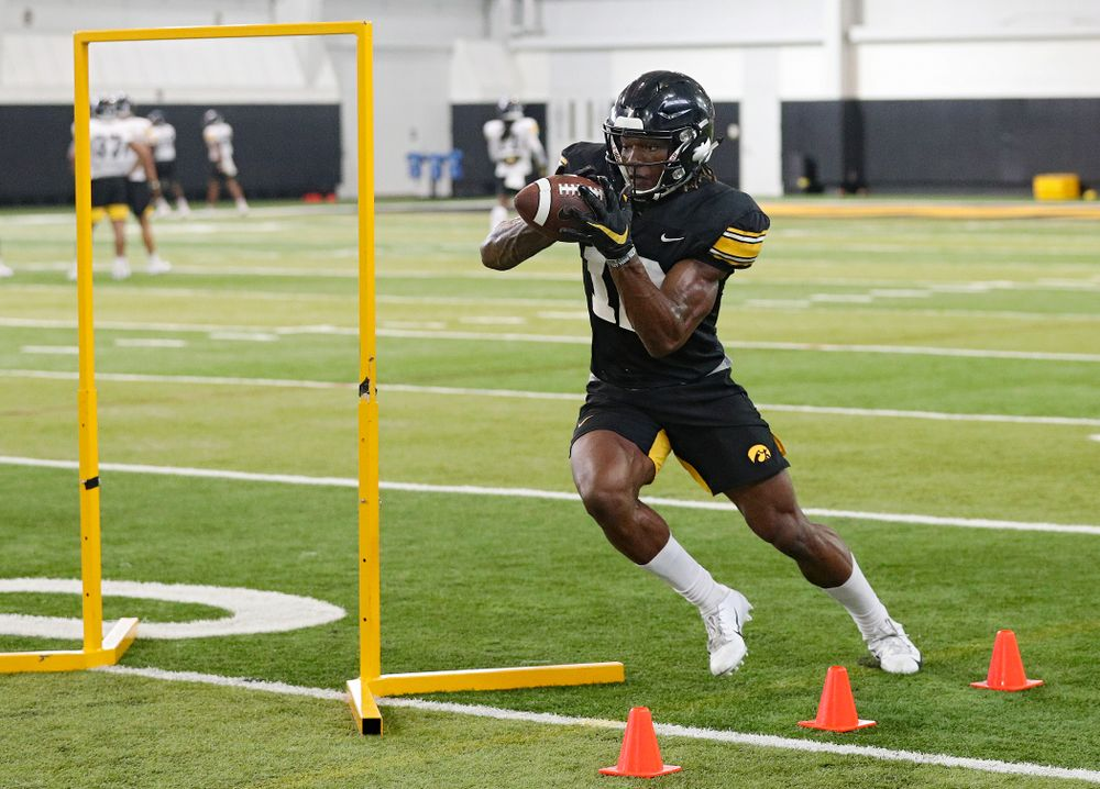 Iowa Hawkeyes wide receiver Brandon Smith (12) pulls in a pass during Fall Camp Practice No. 9 at the Hansen Football Performance Center in Iowa City on Monday, Aug 12, 2019. (Stephen Mally/hawkeyesports.com)