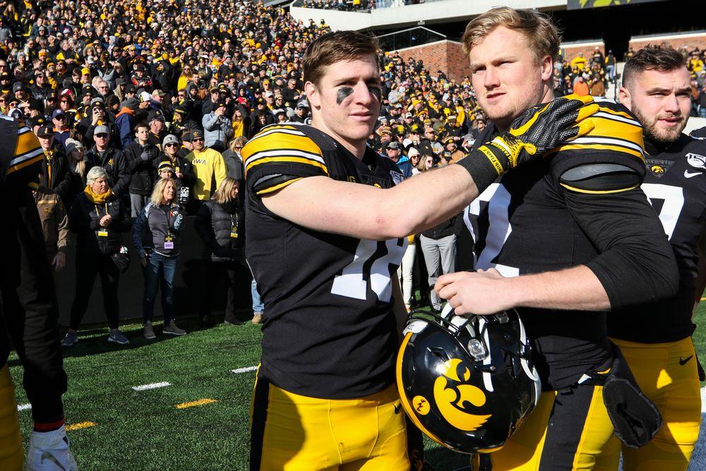 Iowa Hawkeyes defensive back John Milani (18) and Iowa Hawkeyes punter Michael Sleep-Dalton (22) during Iowa football vs Illinois on Saturday, November 23, 2019 at Kinnick Stadium. (Lily Smith/hawkeyesports.com)