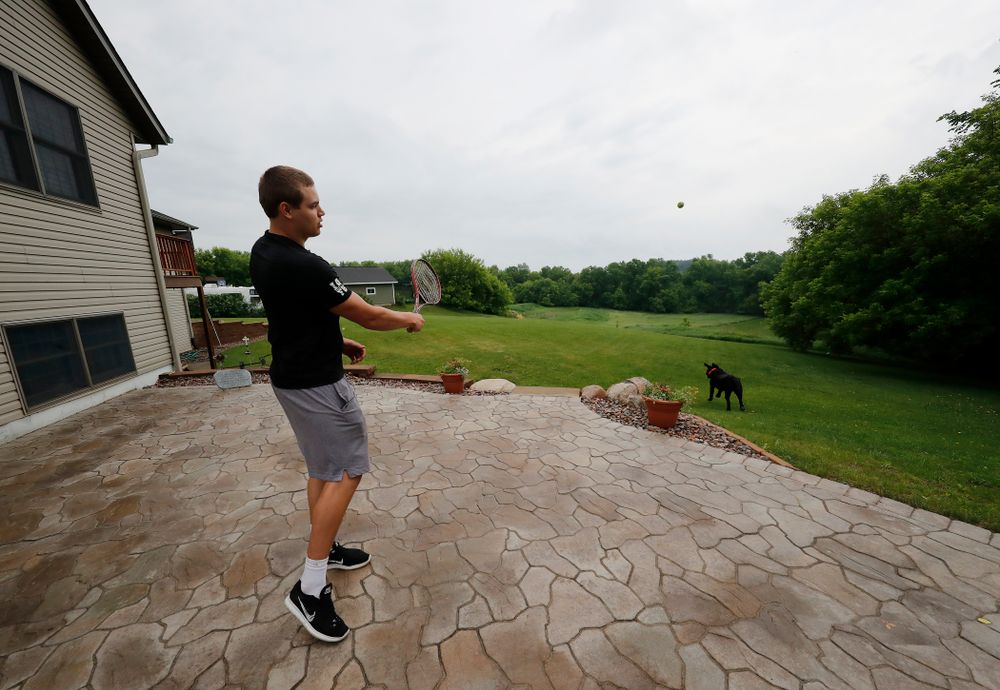 Iowa Hawkeyes quarterback Nathan Stanley (4) plays with his dog Onyx at his home Wednesday, May 30, 2018 in Menomonie, Wisc. (Brian Ray/hawkeyesports.com)