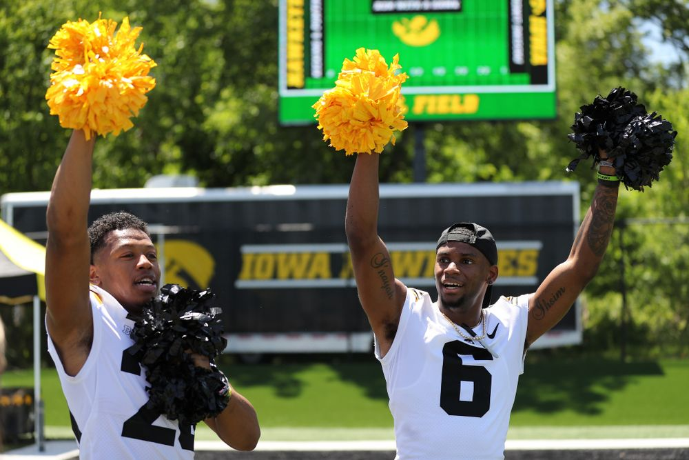 Iowa Hawkeyes defensive back Kaevon Merriweather (26) and wide receiver Ihmir Smith-Marsette (6) during the 2019 Iowa Ladies Football Academy Saturday, June 8, 2019 at the Hansen Football Performance Center. (Brian Ray/hawkeyesports.com)