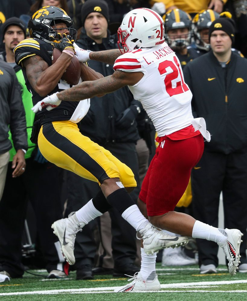 Iowa Hawkeyes wide receiver Brandon Smith (12) makes a first down reception during a game against Nebraska at Kinnick Stadium on November 23, 2018. (Tork Mason/hawkeyesports.com)