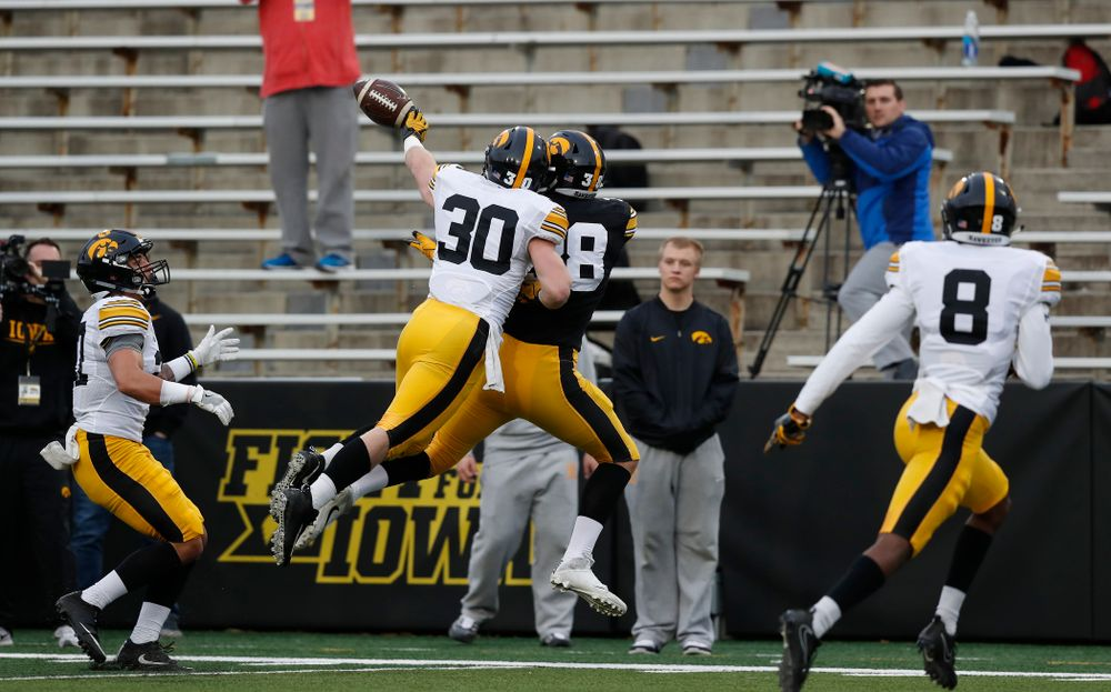 Iowa Hawkeyes defensive back Jake Gervase (30) and tight end T.J. Hockenson (38) during the final spring practice Friday, April 20, 2018 at Kinnick Stadium. (Brian Ray/hawkeyesports.com)
